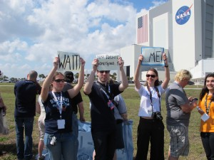 Tweetuppers hold up a sign for the astronauts
